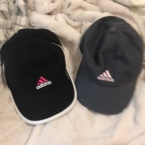 Two adidas woman's  climalite caps.
